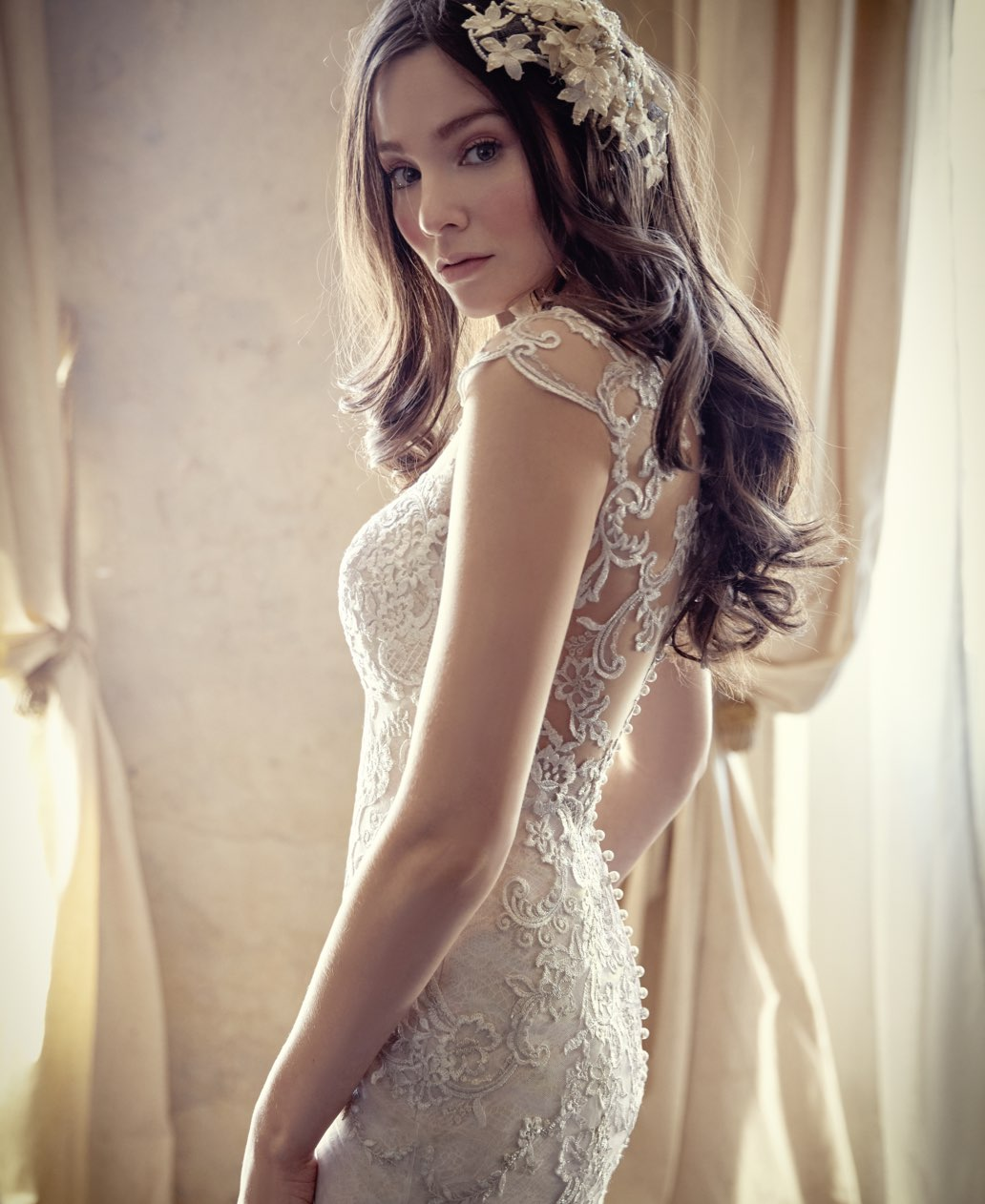 Model wearing white Maggie Sottero Wedding Gown. Desktop
